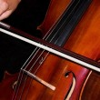 Feminine hands playing cello — Stock Photo