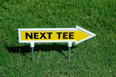 Next tee sign — Stock Photo