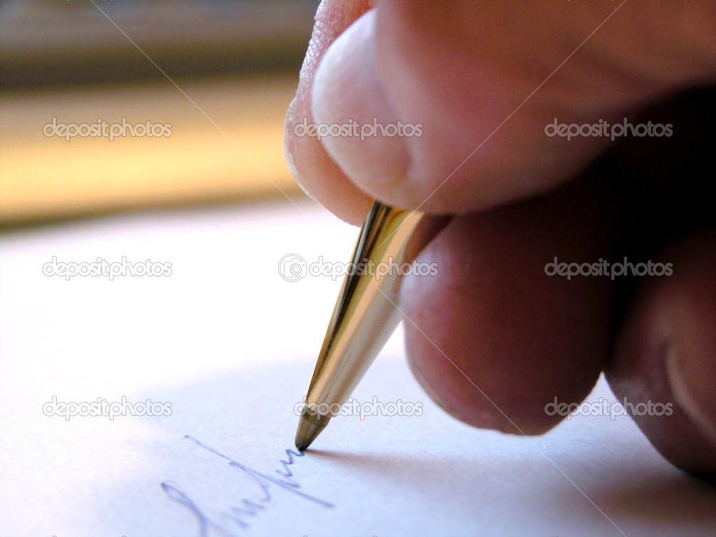 Writing with a pen  Stock Photo #2120642