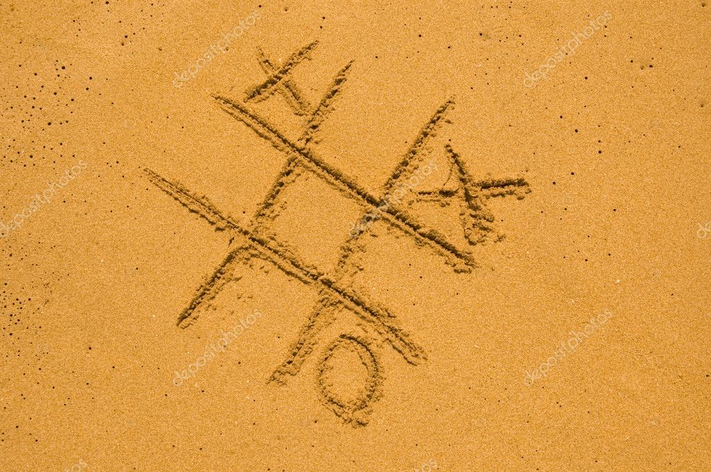 X and O game on the sand — Stock Photo #2312202