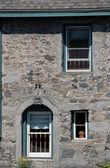 Stone wall & windows — Stock Photo