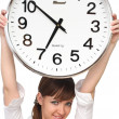 Woman holding big alarm clock — Stock Photo #1945954
