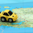 Small car on map — Stock Photo #1949684