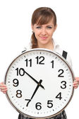 Beautiful woman with big clock — Stock Photo