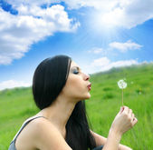 Beautiful woman with dandelion — Stock Photo
