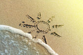 Sun drawing on a beach — Stock Photo