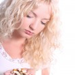 Young blond woman taking tablet — Stock Photo #1958196