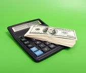 Calculator and banknotes — Stock Photo