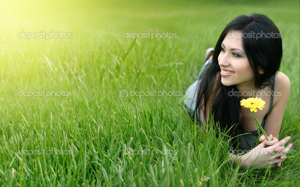 Beautiful young woman relaxing in the grass — Stock Photo #1972640
