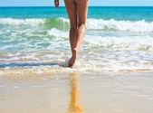 Woman legs and sea — Stock Photo