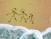 Family drawing on beach — Stock Photo