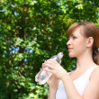 Beautiful woman water bottle — Stok fotoğraf