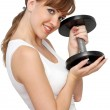 Beautiful woman with dumb-bells — Stock Photo #1990749