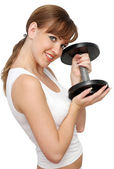 Beautiful woman with dumb-bells — Stock Photo
