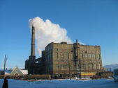 Polluting factory and blue sky — Stock Photo