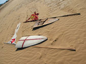 Middle Ages shields and flags in sand — Stock Photo