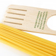 Spaghgetti and spaghetti servings — Stock Photo