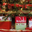 Home decorated tree with gifts — Stock Photo