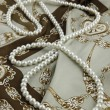 White Pearls on a designer scarf — Stock Photo #2232416
