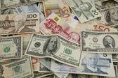 Layers of international paper money — Stock Photo