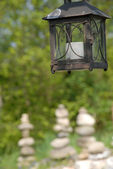 Lantern and stones — Stock Photo