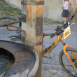 Bike and fountain — Stock Photo