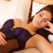 Beautiful young woman sleeping in bed - Foto Stock