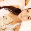 Woman in bed in the morning — Stock Photo