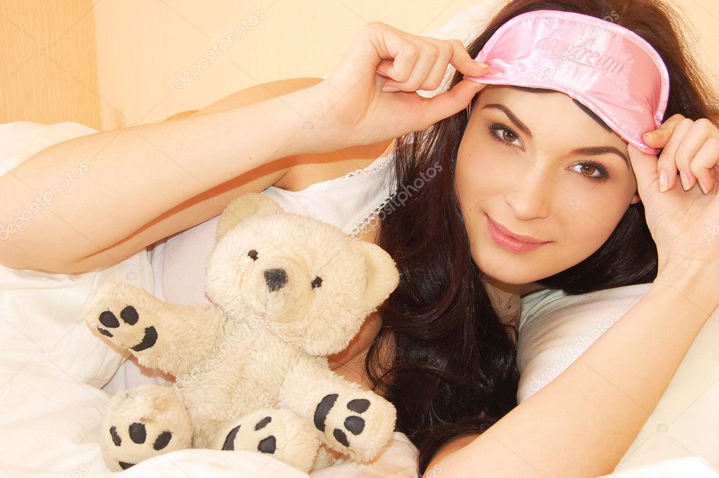 Beautiful young girl in bed in the morning   Stock Photo #1969545