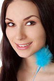 Beautiful young brunette with blue fluff — Stock Photo