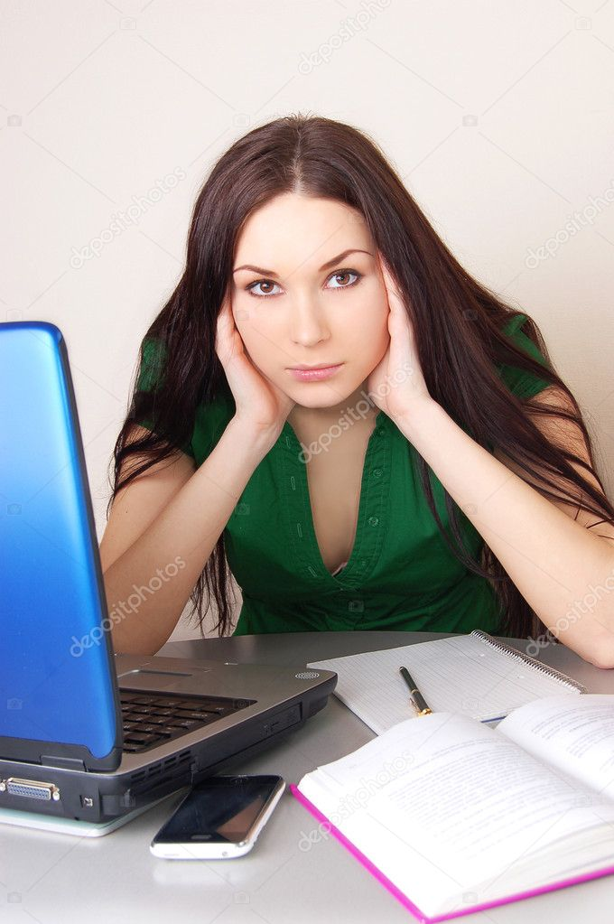 Portrait of a stressed young woman near laptop isolated   Stock Photo #1987787