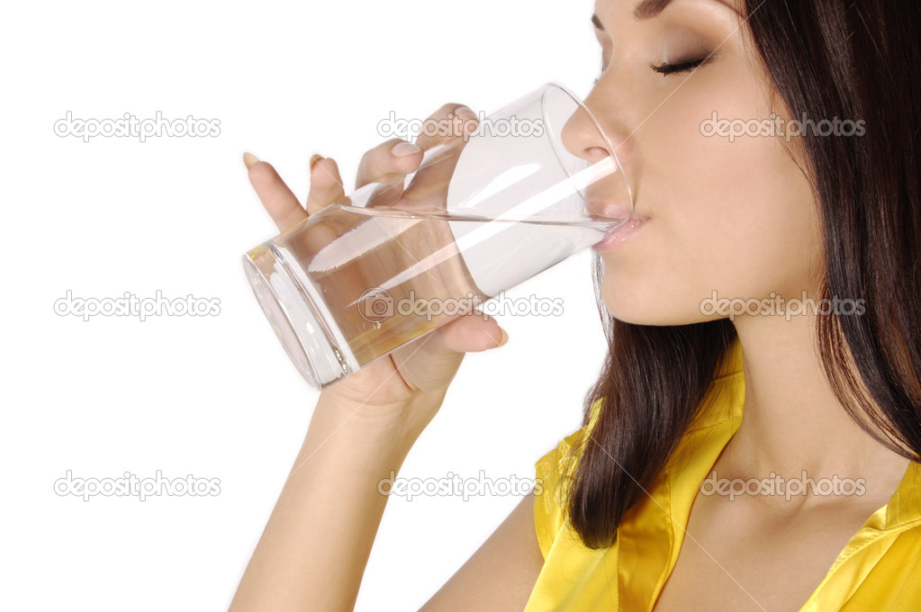 Beautiful young girl drinks water from glass isolated on white — Stock Photo #2107432