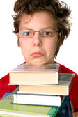 Upset boy with set of books — Stock Photo