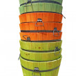 Stacked colorful wooden buckets isolated — Stock Photo #2075410