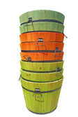 Stacked colorful wooden buckets isolated — Stock Photo