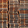 Stock Photo: Stacked wooden pallet columns