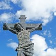 Stock Photo: Weathered graveyard crucifixion statue