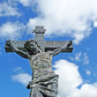 Weathered graveyard crucifixion statue — Stock Photo