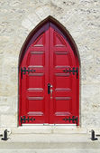 Nineteenth century red church door — Stock Photo