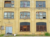 Grungy industrial building exterior — Stock Photo