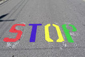 Stop stencil on road false color — Stock Photo