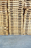 Stacked wooden pallet columns — Stock Photo