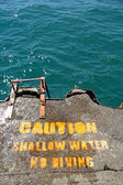 Breakwater warning sign — Stock Photo