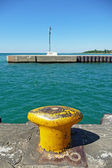 Harbor channel bollard with signal light — Stock Photo