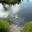 Canoeists and kayaker from cliff view — Stock Photo
