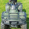 Staffie atop an all terrain vehicle — Stock Photo