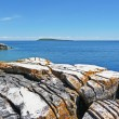 Rocky coast with island horizon — Stock Photo #2190942