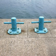 Two blue harbor bollards — Stock Photo