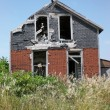 Decaying abandoned rural house — Stock Photo