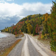 Coastal gravel road in autumn — Stock Photo